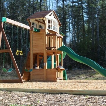 Playground border using wooden landscape timbers with wood chips