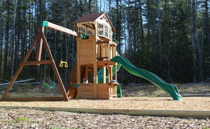 Playground border with wooden landscape timbers and wood chips