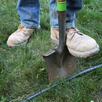 edging garden bed using a flat edging shovel