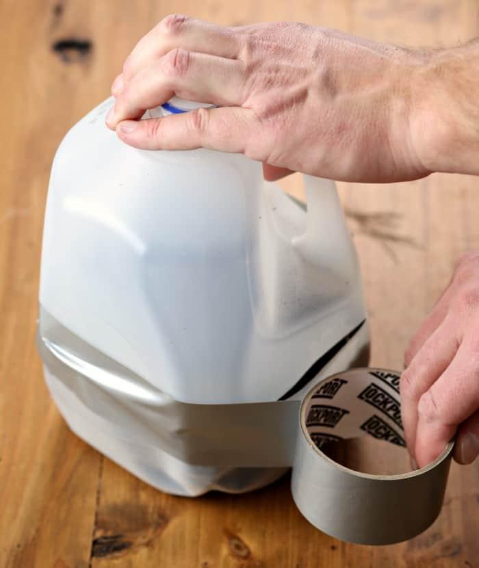 using duct tape to tape seam of milk jug